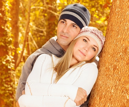 Closeup portrait of cute couple hugging in autumn park, young family having fun in autumnal woods, boyfriend with girlfriend enjoying fall nature on backyard, romantic dating, love concept Stock Photo - 16010602