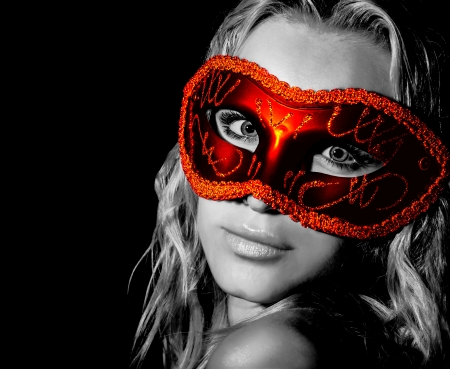 black mask: Mysterious woman wearing decorative face mask, girl at holiday party celebration, sexy female in red light isolated on black background, New Year and Christmas fashion costume, black and white