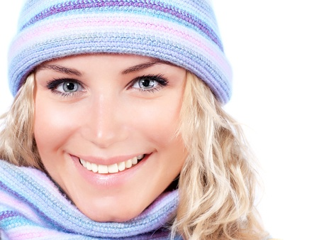 Happy girl in winter hat, beautiful young female wearing knitted warm wintertime clothing, expressing positive emotions, cheerful model, close up on pretty woman face, Christmas fashion photo