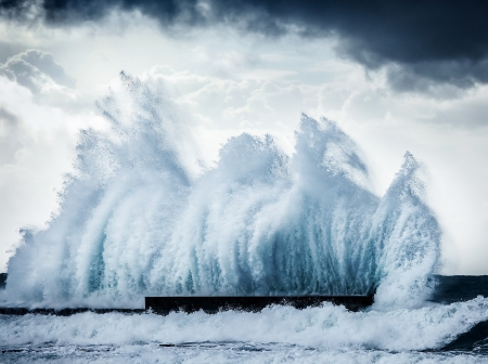 Giant wave splash, beautiful dark dramatic seascape, ocean storm landscape, power of nature, natural disaster, cold extreme weather, strong powerful wind, water action photo