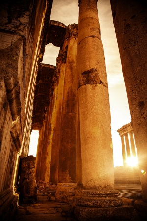 heliopolis:  Jupiters temple Baalbek, Lebanon, ancient city ruins, retro grunge style picture with bright sun light, old town on sunset, historical monument, religious castle ruin, mediterranean culture
