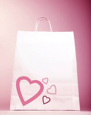 spending money: Image of white shopping bag with heart isolated on pink background, Valentines day, birthday present bag, new romantic purchase, spending money, market sack, hearts decoration, love concept  Stock Photo
