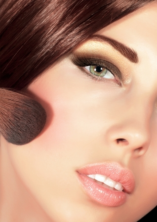 Picture of gorgeous woman with brown silky hair doing evening makeover, sexy look, smoky eyes, fashionable makeup, stylish visage, professional cosmetics brush and tassel, luxury beauty salon Stock Photo - 16367628