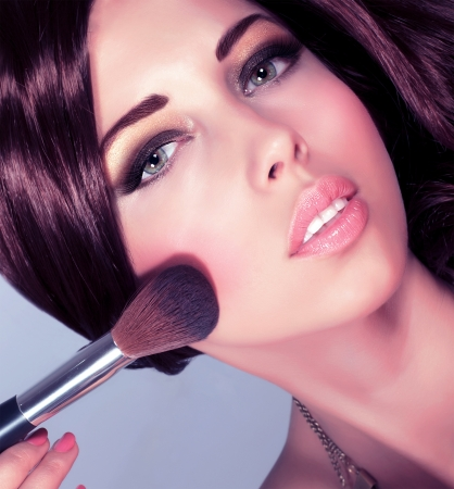 Photo of young sexy lady with perfect makeup, closeup portrait of pretty woman apply tassel to doing cute blush, cosmetics tools, beauty salon, Christmas eve, New Year party, gorgeous lifestyle Stock Photo - 16367632