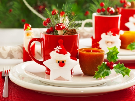 Picture of beautiful Christmas table setting, shining white plate with red cup for coffee decorated holiday dinner, branch of berry and santa claus star on festive dishware, New Year party, xmas eve  photo