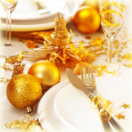 Picture of Christmas table setting still life, festive white utensil decorated with golden candle and shiny xmas tree ball toys, romantic holiday dinner, New Year party, luxury table decorations Stock Photo - 16510415