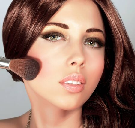 Picture of pretty woman with stylish makeup, cute girl holding brush for blush, sexy female with gloss brown hair, fashionable beauty salon, luxury lifestyle, perfect complexion, New Year party Stock Photo - 16510469