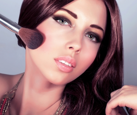 Image of attractive female doing stylish evening makeover, smoky eyes, perfect skin tone, beautiful brunet woman wearing fashionable golden necklace, beauty salon, Christmas eve party, New Year Stock Photo - 16510468
