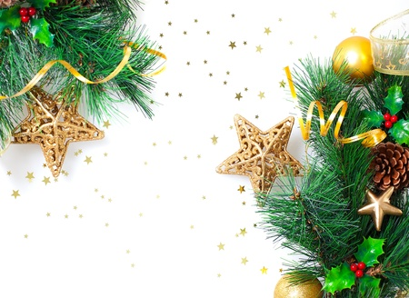 fir cones: Photo of Christmastime border, Christmas tree branch decorated with golden stars