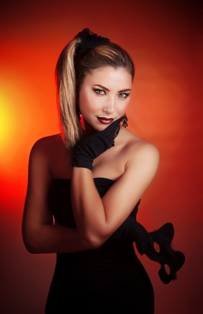 Photo of pretty woman holding mask of cat in hand Stock Photo - 16632090