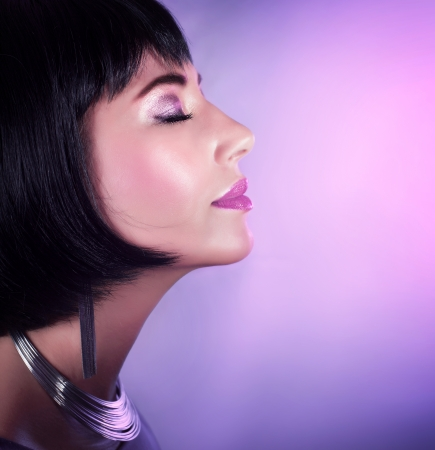 woman profile face: Image of stylish girl wearing fashionable accessories isolated on purple background Stock Photo