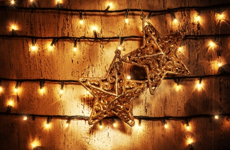 Picture of luxury star decorations hanging on the door adorned with Christmas lights photo