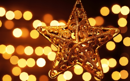 Image of beautiful golden star decoration isolated on festive blur lights background photo
