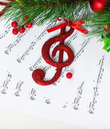 Image of red festive treble clef on the notes paper photo