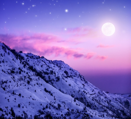 snow covered mountain: Photo of beautiful snowy mountains on purple sunset background, Faraya mountain in Lebanon covered with white snow, wintertime cold weather, moonlight in dark night, winter holidays concept