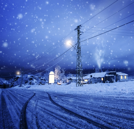 snowstorm: Photo of blizzard in the village, snow falling on the house, night wintertime landscape, Christmastime greeting card, winter holiday, luxury ski resort, cozy homes in Lebanon, Xmas vacation concept