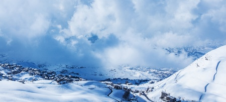 Picture of little village in snowy mountains, beautiful nature landscape, house covered with snow in Faraya mountain location, winter resort, frosty weather, outdoor panorama, holiday greeting card photo