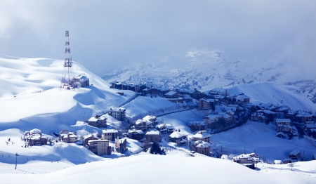 Photo of luxury winter resort, Christmas and New Year holiday, countryside lodges covered with white snow, Faraya mountains in Lebanon, cold frosty weather, snowy mountain landscape