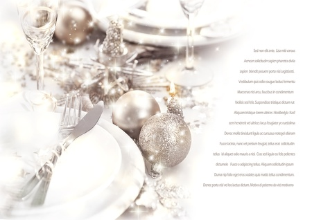 festive: Image of romantic holiday dinner, festive table setting decorated with beautiful silver bubbles and candles, luxury white plate served with shiny knife and fork, wedding day, love story