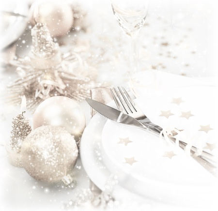 dishware: luxury festive table setting, beautiful white dishware decorated with silver baubles and candles, elegant plate served with knife and fork, Christmastime home interior, New Year dinner