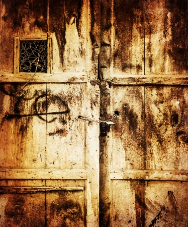 barn door: Image of old wooden dirty door background, retro style , grungy entrance into house, locked door, aged scratched texture, building concept, vintage wallpaper  Stock Photo
