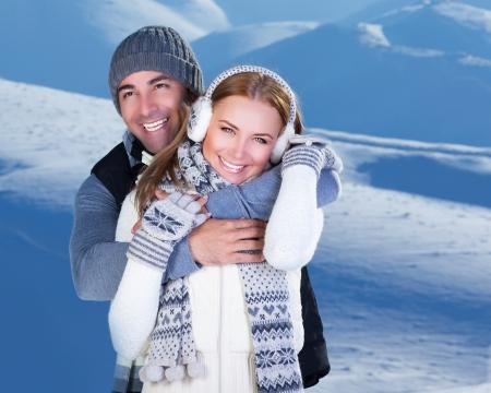 winter couple: Happy couple hugs