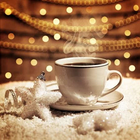 Photo of luxury white cup with tasty coffee, Christmastime table setting, tea mug on brown glowing background, festive star decoration, New Year ornament, Christmas home decor Stock Photo