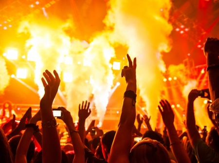 nightclub crowd: Photo of rock concert, music festival, New Year eve celebration, party in nightclub, dance floor, disco club, many people standing with raised hands up and clapping, happiness and night life concept