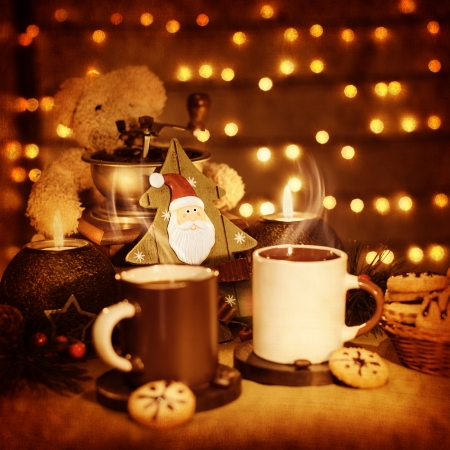 Image of beautiful Christmastime still life, traditional gingerbread with coffee cups on the table, teddy bear with decorative wooden Christmas tree adorn holiday dessert, New Year greeting card photo