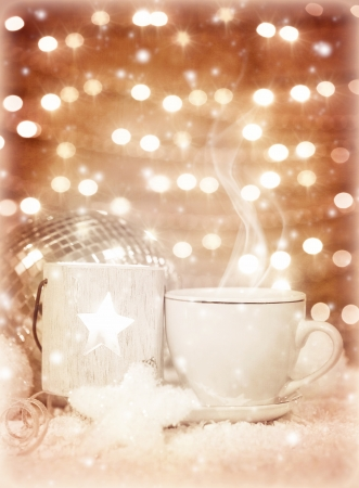 Picture of beautiful luxury white cup of tea on festive glow background, New Year greeting card, home Christmastime decor, hot chocolate drink, restaurant table setting, winter holidays photo