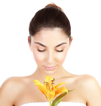 Photo of pretty woman enjoying dayspa, closeup portrait of attractive female with closed eyes holding yellow lily flower isolated on white background, luxury spa salon, beauty treatment concept Stock Photo - 17415518