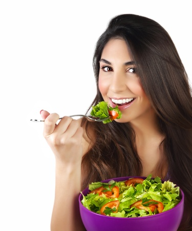 Picture of pretty woman eating green salad, closeup portrait of brunette female holding bowl with fresh vegetables isolated on white background, healthy lifestyle, organic nutrition, dieting concept Stock Photo - 17415566
