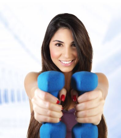 Photo of attractive sporty woman lifting dumbbell, active female doing fitness exercise indoor, isolated on white background, healthy lifestyle, training and loss weight, sport gym, health and beauty Stock Photo - 17415528