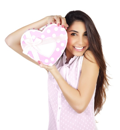 Image of pretty woman with pink present box isolated on white background, attractive female holding in hands gift heart-shaped, Valentine day, romantic holiday, love concept Stock Photo - 17415541