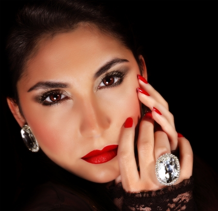 Photo of luxury female wearing stylish jewelery, closeup portrait of beautiful woman with seductive makeup isolated on black background, sexy girl, red lips, Valentine day, beauty and elegance concept photo