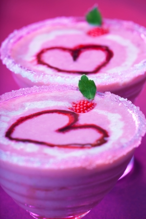Image of tasty sundae with red romantic heart shape on the top, Valentine day holiday party, strawberry creamy smoothie with mint, nonalcoholic milk cocktail, cold ice cream, love concept photo