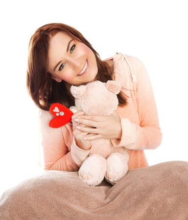 Picture of pretty woman with soft bear toy in bed, sweet young lady received gift for Valentine day, lovely brunette teen girl with romantic present isolated on white background, love concept Stock Photo - 17415571