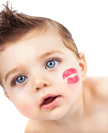 beautiful lips: Picture of small pretty kid with red lipstick kiss on the cheek, closeup portrait of cute baby boy isolated on white background, curious toddler with open mouth looking in the camera, Valentines day