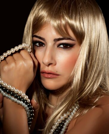Image of beautiful blond woman isolated on black background, closeup portrait of young sexy lady wearing luxury pearl necklace, gorgeous female with stylish seductive makeup, vogue concept Stock Photo - 17415576
