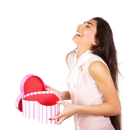 Image of pretty happy woman opening gift box isolated on white background, brunette female enjoying of present, cute teen girl laughing, romantic holiday, Valentine day, love concept photo