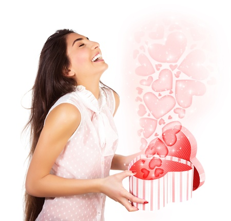 Photo of beautiful woman opened present box, cute female holding in hands open heart-shaped gift isolated on white background, romantic holiday, Valentines day, love concept photo