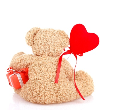 teddybear: Image of cute furry teddy bear sitting back side and holding little gift box and red heart-shaped balloon, soft toy as present for Valentines day holiday, 14 of february, romantic date, love concept