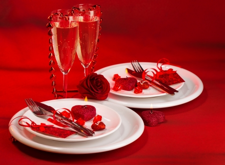 festive table setting, luxury white dishware on red tablecloth, hearts decorations, beautiful rose flower, two glasses for wine, alcohol drink, romantic date, Valentine day, love concept photo