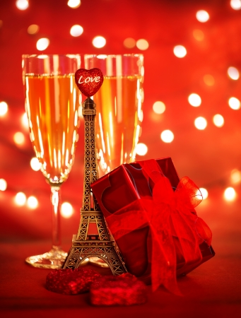 Photo of two champagne glass with red gift box and Eiffel tower, honeymoon vacation, romantic date, Valentine day, travel to Europe, sparkling wine, holiday dinner, luxury lifestyle, love concept photo