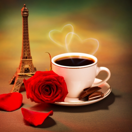 Conceptual photo of romantic trip to France, beautiful morning in Paris, food still life, cup of coffee with piece of chocolate and fresh red rose on the table in cafe, honeymoon travel, Valentine day photo
