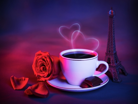 romantic trip to France, beautiful night in Paris, food still life, cup of coffee with piece of chocolate and fresh red rose on the table in cafe, honeymoon travel, Valentine dinner photo