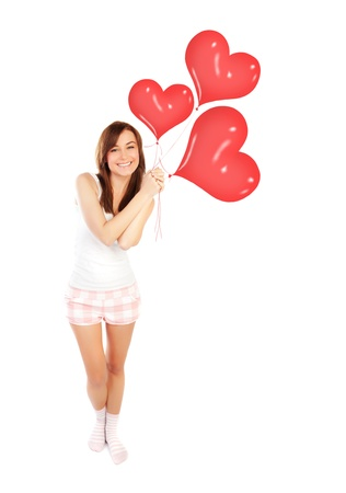 adult valentine: Image of a cute happy girl holding red heart balloons, fit woman smiling isolated on white background, freedom lifestyle, weight loss concept, romantic wish on Valentine day, love happiness and health