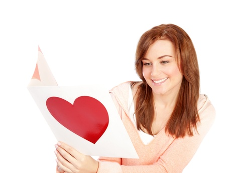Image of happy beautiful female reading romantic greeting card with big red heart, attractive brunette woman got love letter, cheerful girl expressing happiness on Valentine day, in love concept photo