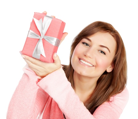 Picture of a happy young adult girl with gift box, cheerful female isolated on white background, pretty woman portrait with romantic present, holiday celebrations concept photo