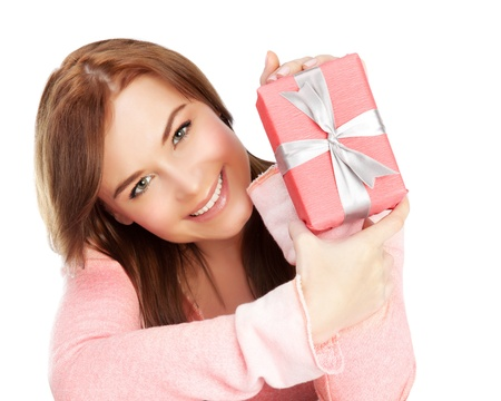 got: Picture of a happy young adult girl with gift box, cheerful female isolated on white background, pretty woman portrait with romantic present, holiday celebrations concept Stock Photo